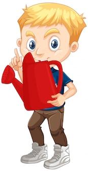 Ładny chłopak trzymając czerwoną konewkę