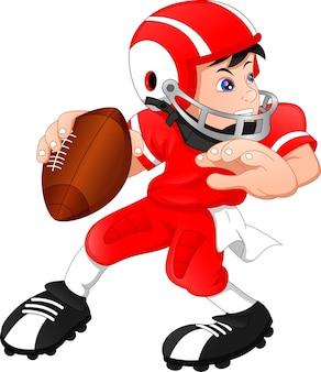 Ładny chłopiec pozowanie na sobie futbol amerykański