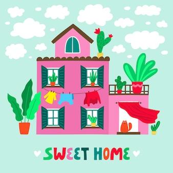 Ładny dom pomarańczowy rodzinny z napisem fraza sweet home. letni domek z piękną przyrodą i kwitnącymi roślinami. posiadłość wiejska. kreskówka kolorowy