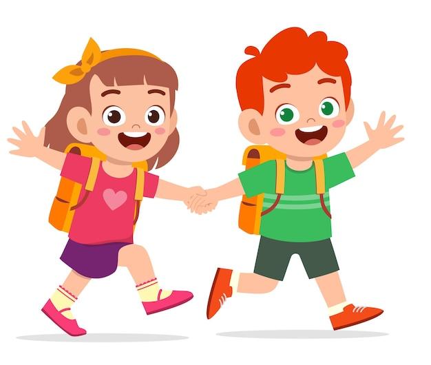 Ładny dzieciak chłopiec i dziewczynka, trzymając się za rękę i razem chodzić do szkoły