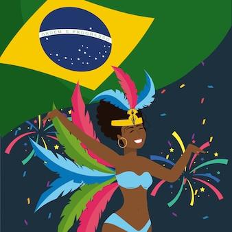 Ładny dziewczyna tancerz z piórami i flaga brazylii
