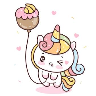 Ładny jednorożec trzymając balon cupcake