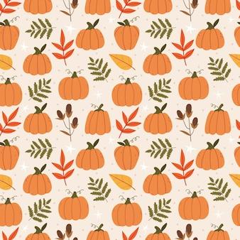 Ładny jesienny wzór z dyniami i liśćmi jesienny nastrój