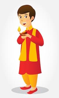 Ładny karton indyjski chłopiec trzymający diya