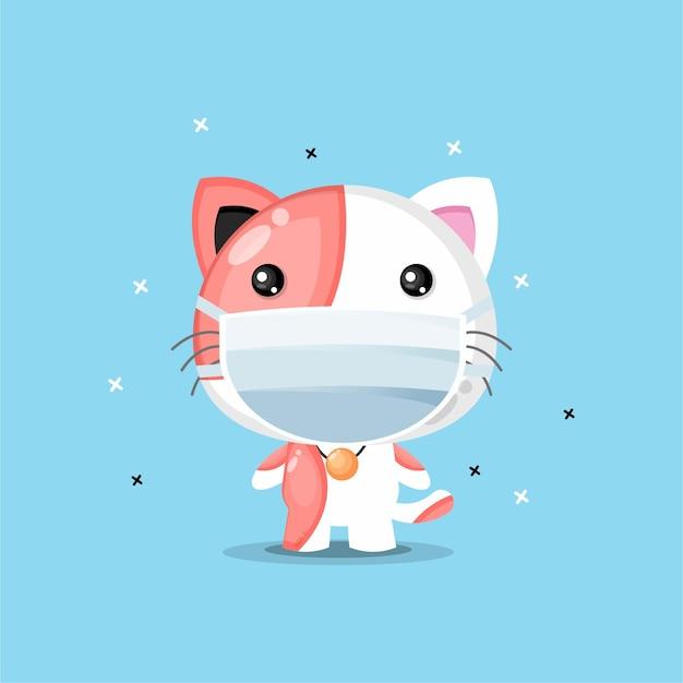 Ładny kot za pomocą maski medycznej