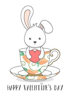 Ładny króliczek w filiżance, trzymając serce