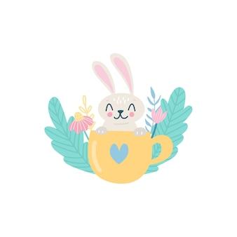 Ładny królik wielkanocny w filiżance z ilustracji kwiatów i ziół