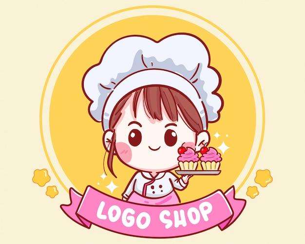 Ładny kucharz trzyma babeczki wiśniowe na logo sklepu