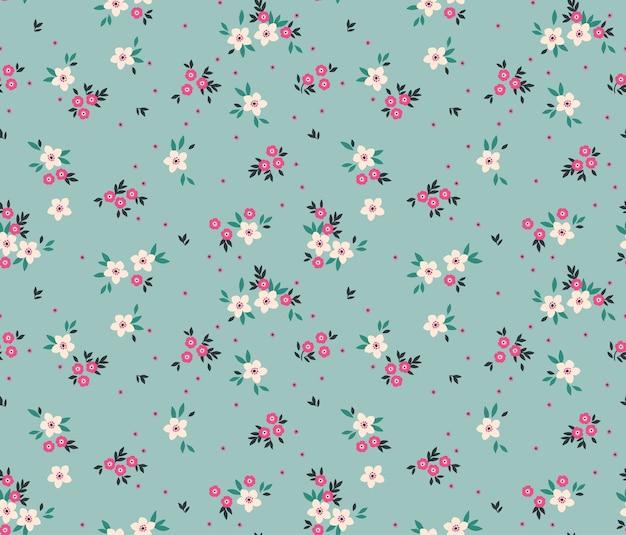 Ładny kwiatowy wzór w małe białe kwiaty.