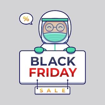 Ładny lekarz niosący transparent sprzedaży w czarny piątek
