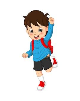 Ładny mały chłopiec chodzić do szkoły