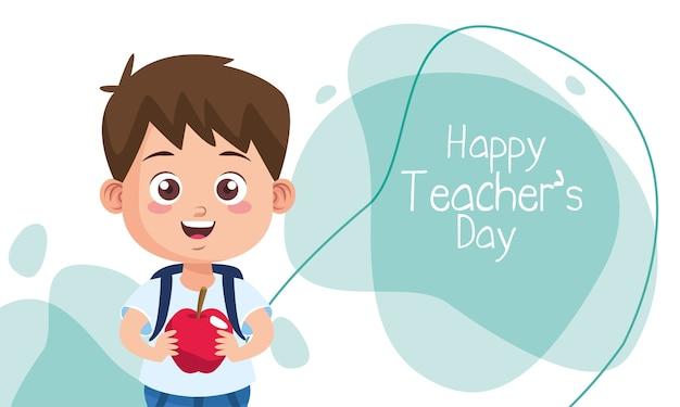 Ładny mały chłopiec uczeń z napisem dzień jabłka i nauczyciela
