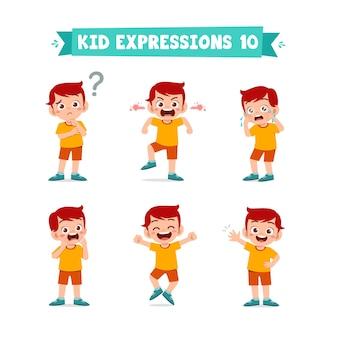 Ładny mały chłopiec w różnych wyrażeniach i zestawie gestów