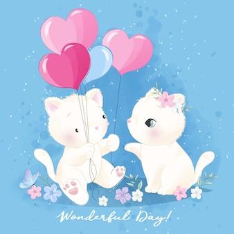 Ładny mały kotek trzyma balon kształt miłości