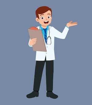 Ładny, przystojny młody lekarz stojący z wyjaśnieniem pozie