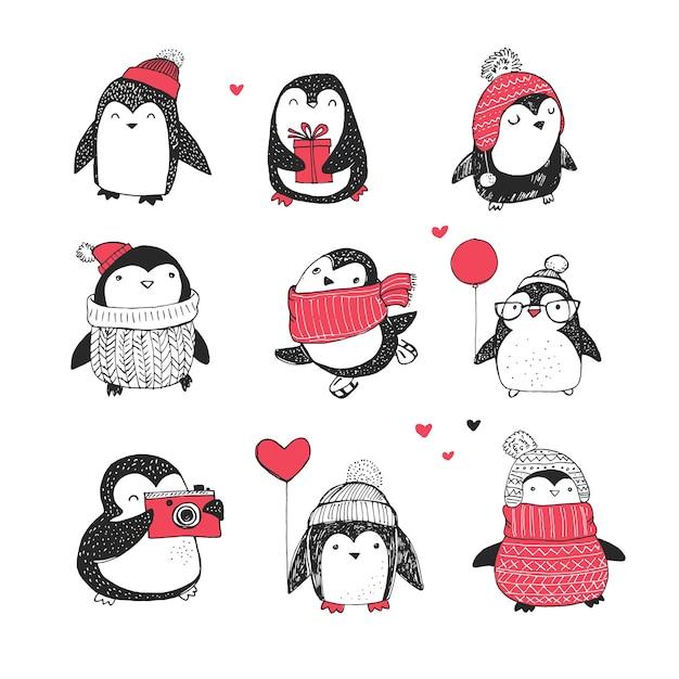 Ładny ręcznie rysowane, pingwiny wektor zestaw - życzenia wesołych świąt