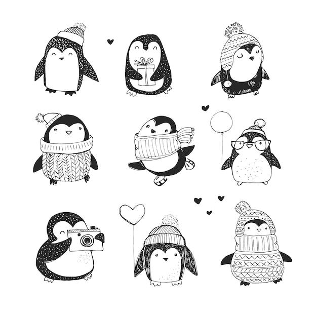 Ładny ręcznie rysowane pingwiny zestaw - życzenia wesołych świąt