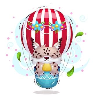 Ładny ryś leci balonem na niebie