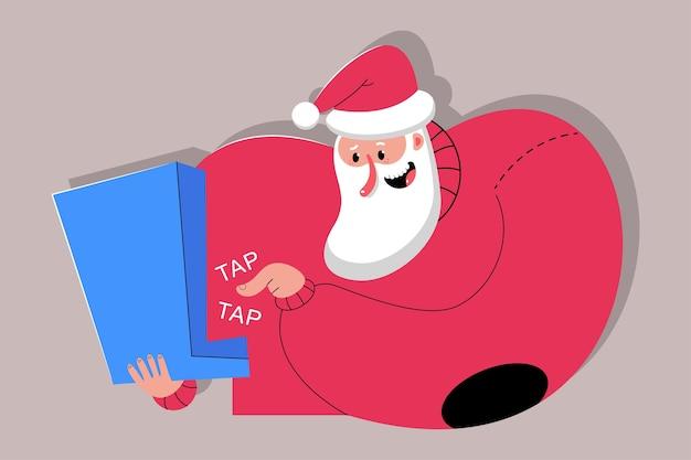 Ładny święty mikołaj z laptopem postać z kreskówki na białym tle na tle
