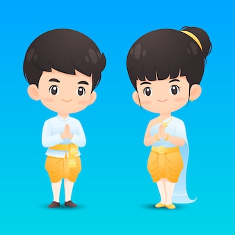 Ładny tajski chłopak i dziewczyna postać w tradycyjnym stroju w akcji pozdrowienia