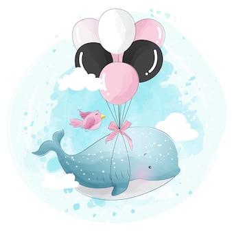Ładny wieloryb leci z balonem