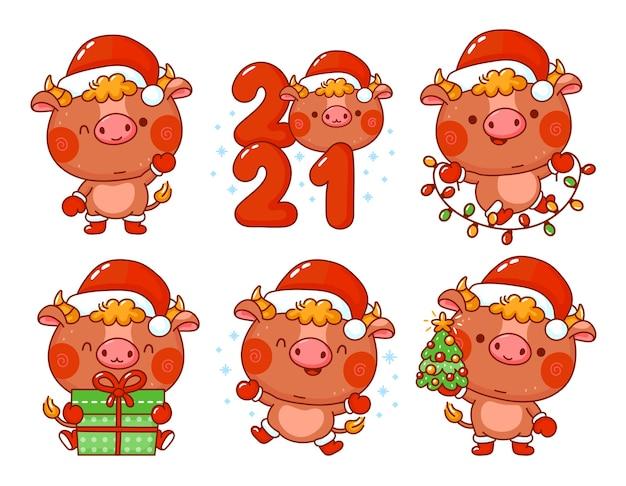 Ładny zabawny symbol nowego roku 2021 byka w zestawie znaków czapki mikołaja. postać z kreskówki kawaii wektorowej