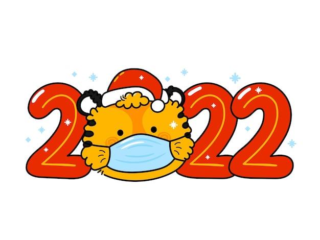 Ładny zabawny symbol nowego roku 2022 tygrys w świątecznej czapce i masce
