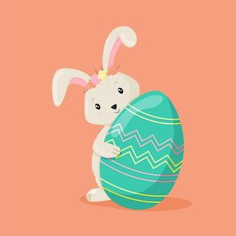 Ładny żeński królik z jajkiem. kolorowy króliczek na kartkę wielkanocną