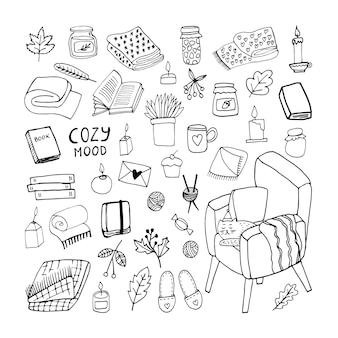 Ładny zestaw jesienny doodle ze słojem dżemu pledy w kratę świece z piór książki liście fotela i kot