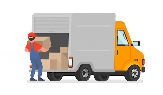 Ładowacz rozładowuje towary z ciężarówki. dostawa. w ruchu