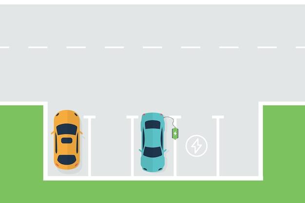 Ładowanie samochodu elektrycznego. samochód ładuje akumulatory ze stacji ładującej ev. widok z góry na parking samochodowy ładowanie pojazdu elektrycznego.