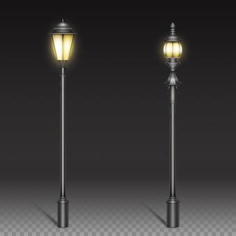 Lampy uliczne w stylu vintage, latarnia z czarnego żelaza na słupku.