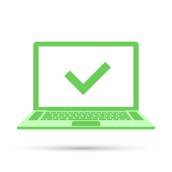 Laptop z znacznikiem wyboru na zielonym ekranie