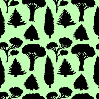 Lasowy bezszwowy wzór z sylwetek drzewami dla twój projekta. czarne i zielone tło