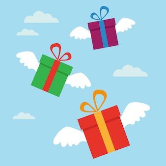Latające prezenty ze skrzydłami na niebie