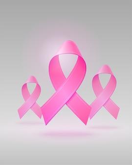 Latające realistyczne różowe wstążki na na białym tle jasnoszarym tle. symbol świadomości raka piersi w październiku.