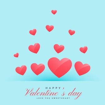 Latające serca na niebieskim tle happy valentine's day