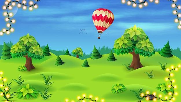 Lato krajobraz z sosnami i drzewami na zielonej łące na tle niebieskie niebo z lotniczym ballon.