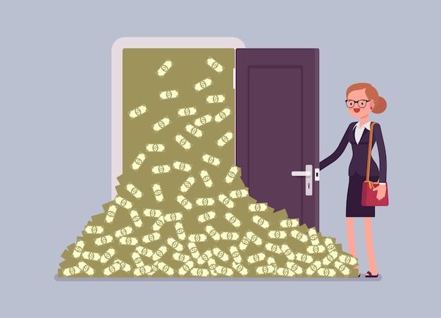 Lawina pieniędzy duża kupa gotówki i bizneswoman