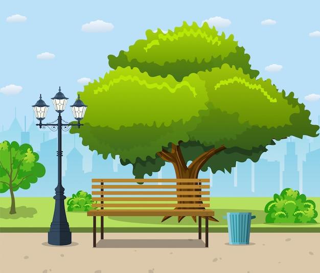Ławka w parku miejskim pod dużym zielonym drzewem