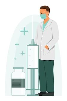 Lekarz mężczyzna nosi maskę medyczną i stoi w pobliżu dużej strzykawki szczepionki