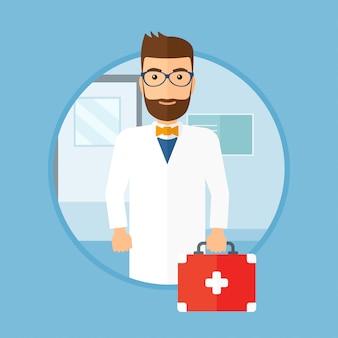 Lekarz z apteczką pierwszej pomocy.