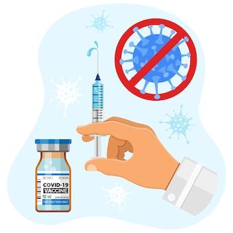 Lekarz ze strzykawką w ręku szczepi wirusa covid-19. szczepionka koronawirusowa w butelce medycznej. leczenie iniekcyjne koronawirusa covid-19. szczepienie wirusa covid 19 korona za pomocą fiolki ze szczepionką i strzykawki