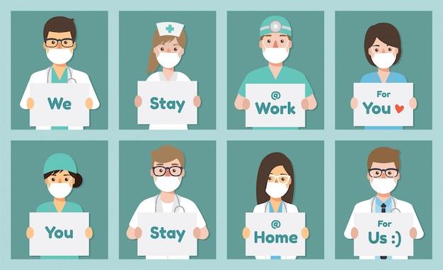 Lekarze, pielęgniarki i personel medyczny z plakatem proszącym o unikanie wirusa corona i rozprzestrzeniania się covid-19 przez pozostanie w domu.