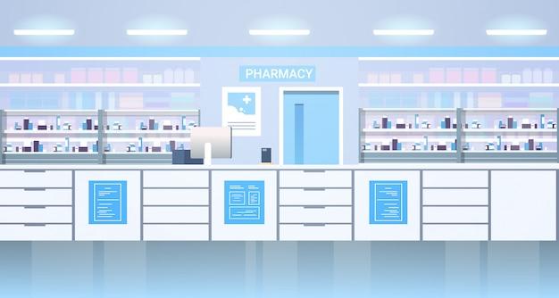 Leki ułożone na półkach opróżniają bez ludzi apteka nowoczesna apteka wnętrze horyzontalne