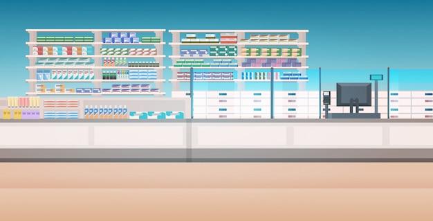 Leki ułożone na półkach opróżniają bez ludzi apteka nowoczesne wnętrze apteki