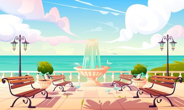 Letni brzeg morza z fontanną i ławkami