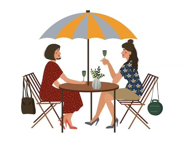 Letnia kawiarnia i dwie dziewczyny.