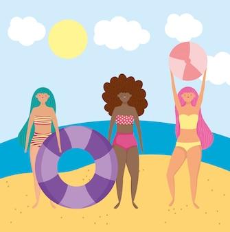 Letnie aktywności ludzi, kobiety z pływakiem i piłką, relaks nad morzem i wypoczynek na świeżym powietrzu