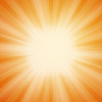 Letnie słońce pękło na pomarańczowym tle z promieniami świetlnymi. lato w tle. letnie promienie słońca.
